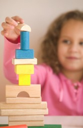 Girl Stacking Building Blocks